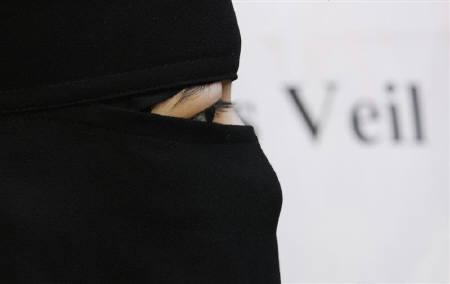 A Muslim woman takes part in a demonstration by the Islamic political party Hizb ut-Tahrir against France's banning of full face veils from public spaces, outside the French Embassy in London September 25, 2010. REUTERS/Luke MacGregor/Files