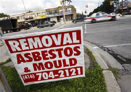 An advertisement for asbestos removal is seen at a nearby propane facility in Toronto, August 11, 2008. REUTERS/Mark Blinch/Files