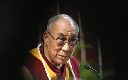 The Dalai Lama listens to a question from a student during a talk at Mumbai University February 18, 2011. REUTERS/Danish Siddiqui