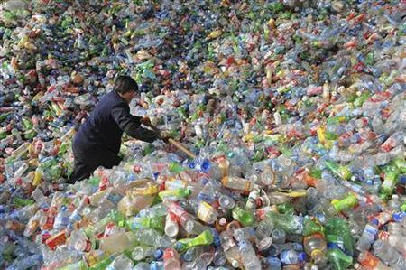A worker sorts plastic bottles at a recycling centre in Hefei, Anhui province November 10, 2010. REUTERS/Stringer