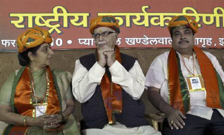 India's main opposition Bharatiya Janata Party (BJP) leaders Sushma Swaraj (L) and Lal Krishna Advani talk as party President Nitin Gadkari (R) watches during their national executive meeting in the central Indian city of Indore February 17, 2010. REUTERS/Raj Patidar/Files