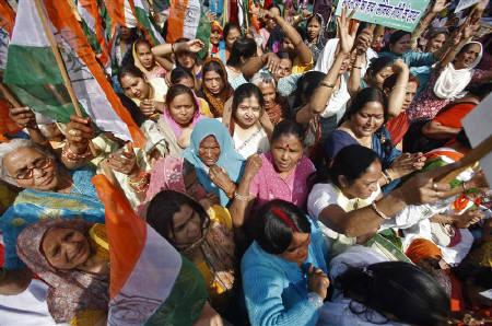 Women activists shout slogans during a protest to demand for their basic rights on International Women's Day in New Delhi March 8, 2011. REUTERS/Parivartan Sharma