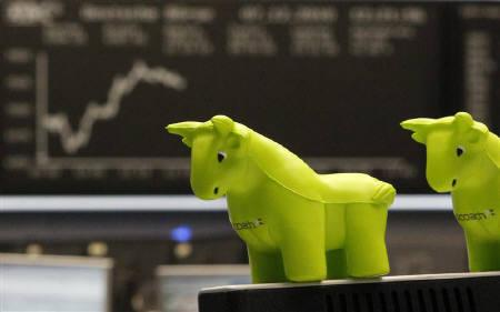 Polystyrene figures of a bull are pictured in front of the DAX board at the Frankfurt Stock Exchange,  December 07, 2010. REUTERS/Alex Domanski/Files