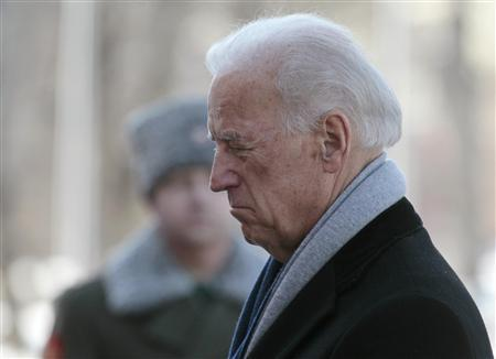 U.S. Vice President Joe Biden pays his respects during a wreath laying ceremony at the Tomb of the Unknown Soldier near the walls of Moscow's Kremlin March 9, 2011. REUTERS/Alexander Natruskin
