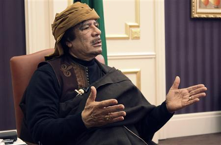 Libya's leader Muammar Gaddafi speaks during an interview with TRT Turkish television reporter Mehmet Akif Ersoy at the Rixos hotel in Tripoli, March 8, 2011. REUTERS/Huseyin Dogan