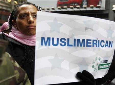A woman holds a sign at the ''Today, I Am A Muslim, Too'' rally in New York City March 6, 2011. The rally was held in response to the upcoming Congressional hearings led by Peter King (R-LI) to protest the targeting of American Muslims and Arabs. REUTERS/Jessica Rinaldi