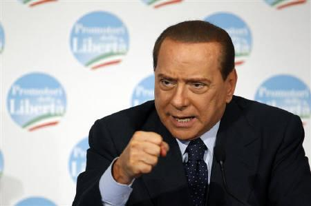 Italy's Prime Minister Silvio Berlusconi gestures as he speaks at a news conference  in Rome February 24, 2010. REUTERS/Alessandro Bianchi/Files