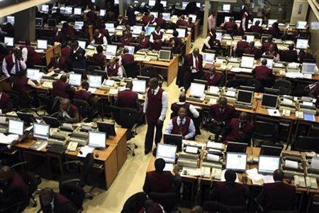 Brokers work on the trading floor of the Nigerian stock exchange in the commercial capital Lagos, April 28, 2010. REUTERS/Akintunde Akinleye