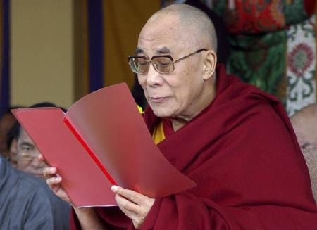 Tibet's exiled Buddhist spiritual leader the Dalai Lama reads during a ceremony marking 52 years since he fled Tibet after a failed uprising against the Chinese, in Dharamsala March 10, 2011.  REUTERS/Stringer