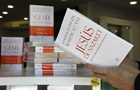 A priest reads the latest Pope Benedict XVI's book ''Jesus of Nazareth'' in a book shop in Rome March 10, 2011. REUTERS/Max Rossi