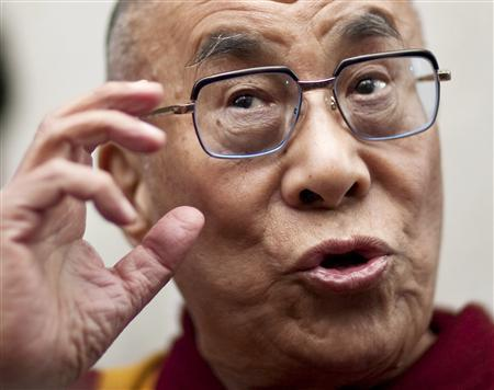 The Dalai Lama speaks to the media in Washington in this February 18, 2010 file photo. REUTERS/Joshua Roberts/Files