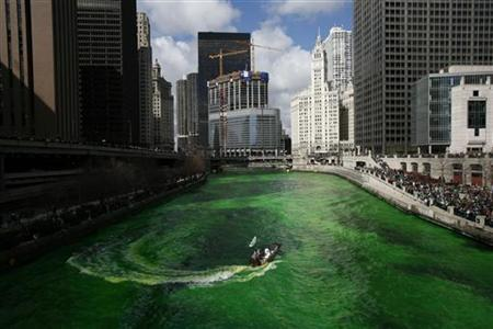 A boat dyes the Chicago River green in celebration of St. Patrick's Day in Chicago March 17, 2007. REUTERS/John Gress