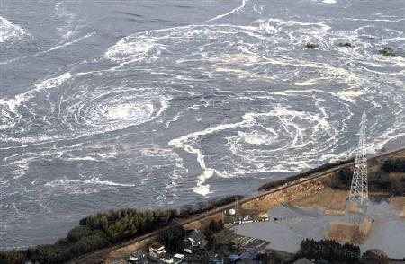 Whirlpools are seen following a tsunami and earthquake in Iwaki city, Fukushima Prefecture, March 11, 2011. REUTERS/YOMIURI