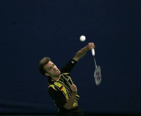 German's Marc Zwiebler returns a shot to Japan's Kenichi Tago during the quarter-final round of the Thomas Cup badminton championship in Kuala Lumpur May 12, 2010. REUTERS/Samsul Said
