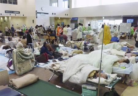 Patients recover in the first-floor lobby of a hospital in Ishimaki City, Miyagi Prefecture in northern Japan, after an earthquake and tsunami struck the area, March 13, 2011. REUTERS/Kyodo
