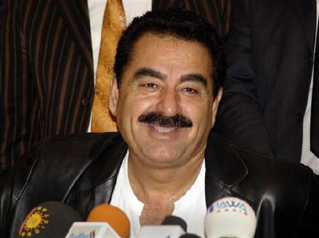 One of Turkey's best known singers, Ibrahim Tatlises, talks at a news conference in Arbil November 17, 2005. Unidentified assailants shot popular Turkish singer Ibrahim Tatlises in the head as he left a TV studio overnight, leaving him in a critical condition, media reports said on Monday. REUTERS/STR New/Files