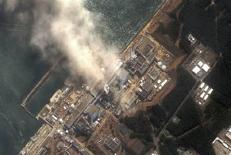 The No.3 nuclear reactor of the Fukushima Daiichi nuclear plant is seen burning after a blast following an earthquake and tsunami in this handout satellite image taken March 14, 2011. DIGITAL GLOBE  REUTERS/Digital Globe/Handout