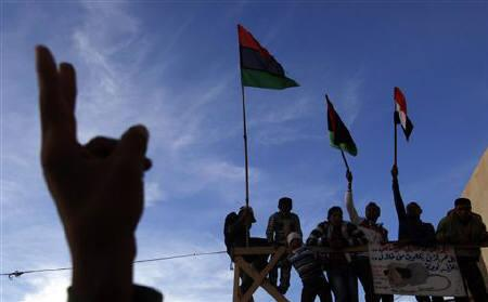 Protesters attend anti-Gaddafi demonstrations in Tobruk, east of Tripoli March 14, 2011. REUTERS/Suhaib Salem