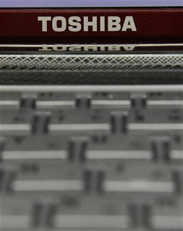 A Toshiba logo is seen on a laptop computer at an electronic shop in Tokyo January 31, 2011. REUTERS/Kim Kyung-Hoon