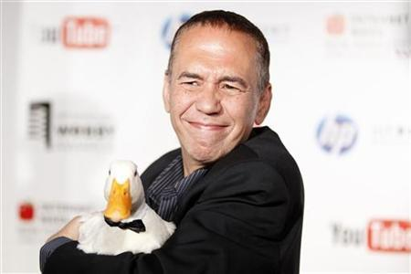 Comedian Gilbert Gottfried arrives with a duck at the Webby Awards in New York June 14, 2010. REUTERS/Lucas Jackson