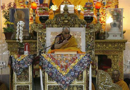 Tibet's exiled spiritual leader the Dalai Lama delivers a teaching session inside a Buddhist temple on the outskirts of the northern Indian hill town of Dharamsala March 15, 2011.   REUTERS/Mukesh Gupta