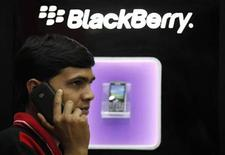 <p>A man speaks on a BlackBerry mobile phone inside a shop in Kolkata January 31, 2011. REUTERS/Rupak De Chowdhuri</p>