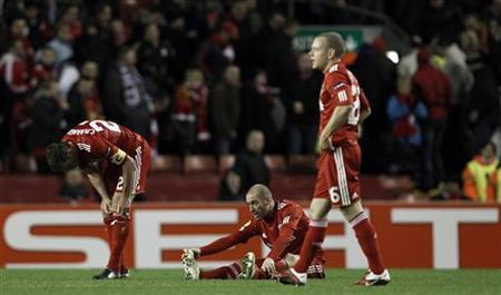 Liverpool's Jamie Carragher (L-R) Raul Meireles and Jay Spearing react after losing to Braga in their Europa League last 16, second leg soccer match at Anfield in Liverpool, northern England, March 17, 2011. REUTERS/Phil Noble