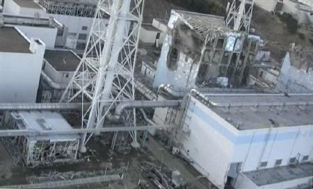 An aerial view taken from a helicopter from Japan's Self-Defence Force shows damage sustained to the No. 4 reactor (C) at the Fukushima Daiichi nuclear power complex in this handout taken March 16, 2011 and released March 17, 2011. REUTERS/Tokyo Electric Power