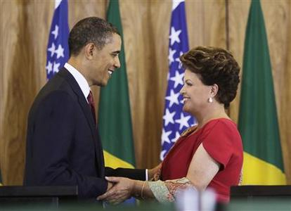 Brazilian President Dilma Rousseff and U.S. President Barack Obama embrace at the end of a joint news conference in Planalto Palace in Brasilia, March 19, 2011. Obama is on the first leg of a three-country tour of Latin America. REUTERS/Ricardo Moraes