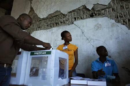 A Haitian man casts his presidential ballot during elections in Port-au-Prince March 20, 2011. Haitians vote in a presidential run-off on Sunday that international donors hope can cement in place the stability needed to rebuild the crippled nation after last year's huge earthquake. REUTERS/Eduardo Munoz