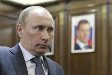 <p>Russia's Prime Minister Vladimir Putin listens to Governor of Sakhalin Region Alexander Khoroshavin, with a portrait of President Dmitry Medvedev in the background, during their meeting in the Far Eastern city of Yuzhno-Sakhalinsk March 19, 2011. REUTERS/Alexsey Druginyn/RIA Novosti/Pool</p>