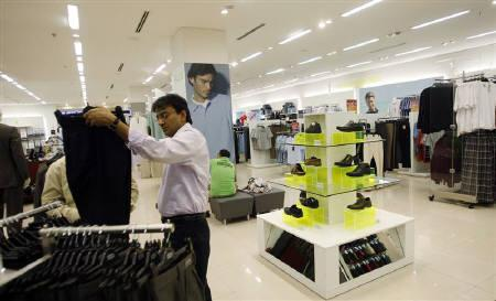 A customer looks at trousers at one of the retail outlets of in Mumbai March 10, 2010. REUTERS/Arko Datta/Files