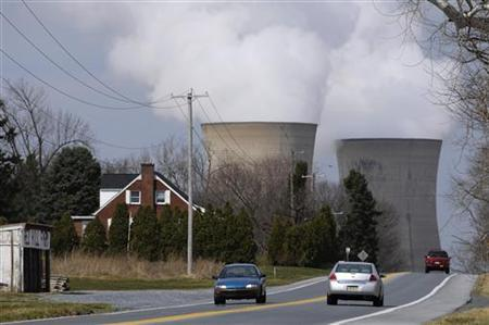 Cars travel on a road near the Three Mile Island nuclear power plant, where the U.S. suffered its most serious nuclear accident in 1979, in Middletown, Pennsylvania March 15, 2011. REUTERS/Jonathan Ernst
