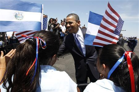 President Barack Obama is welcomed by schoolchildren up his arrival in San Salvador March 22, 2011. REUTERS/Kevin Lamarque