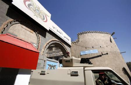 Members of the Republican Guards ride in an armoured personnel carrier stationed at the gate of Yemen's parliament in Sanaa March 23, 2011.  REUTERS/Khaled Abdullah