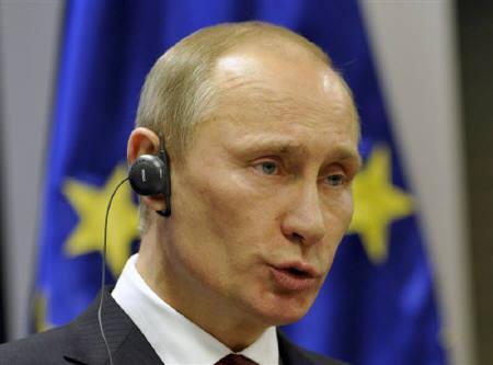 Russia's Prime Minister  Vladimir Putin speaks on a news conference during his visit in Brdo March 22, 2011.  REUTERS/Srdjan Zivulovic