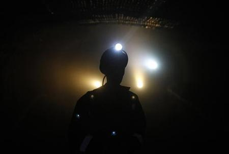 A miner walks through the darkness in a potassium mine near the city of Berezniki in the Perm region close to Russia's Ural mountains March 16, 2011. PREUTERS/Sergei Karpukhin