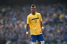 <p>Uma banana foi atirada no campo na direção do atacante brasileiro Neymar durante a vitória de 2 x 0 da seleção brasileira sobre a Escócia em amistoso neste domingo. REUTERS/Kieran Doherty</p>