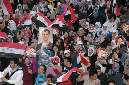 Supporters of Syria's President Bashar al-Assad shout slogans in Syria's northern city of Aleppo March 27, 2011. REUTERS/George Ourfalian