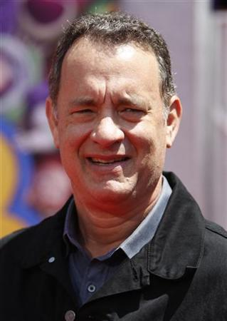 Actor Tom Hanks, who plays with voice of the character Woody, arrives at the world premiere of Disney Pixar's ''Toy Story 3'' at the El Capitan Theatre in Hollywood, California June 13, 2010. REUTERS/Danny Moloshok