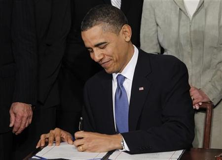 President Barack Obama signs the healthcare legislation during a ceremony in the East Room of the White House in Washington, March 23, 2010. REUTERS/Jason Reed