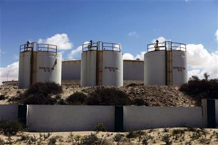 Storage tanks stand at the oil refinery at Zueitina near the northeastern Libyan town of Ajdabiyah March 22, 2011. REUTERS/Finbarr O'Reilly