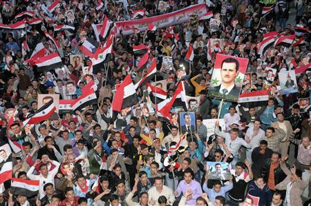 Supporters of Syria's President Bashar al-Assad shout slogans in Syria's northern city of Aleppo, March 27, 2011. REUTERS/George Ourfalian