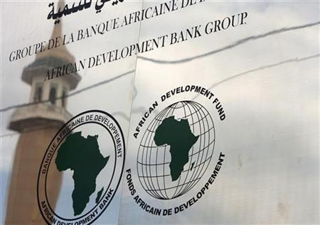 A minaret is reflected in the signage for the newly inaugurated African Development Bank (AFDB) branch in Algiers February 18, 2010. REUTERS/Zohra Bensemra