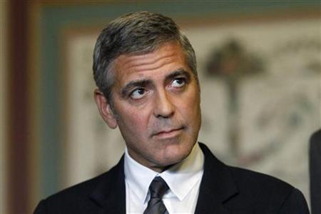 Actor George Clooney listens to human rights activist John Prendergast (not pictured) after a meeting about Sudan with U.S. Senator Dick Lugar (R-IN) on Capitol Hill outside the Senate Foreign Relations room in Washington, October 12, 2010. REUTERS/Hyungwon Kang