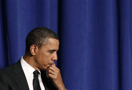 President Barack Obama listens to remarks at the dedication of the Ronald H. Brown United States Mission to the United Nations Building in New York, March 29, 2011. REUTERS/Jim Young