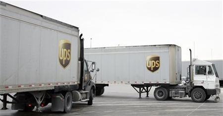 Trucks enter and leave the UPS facility in Hodgkins, Illinois December 16, 2010. REUTERS/Frank Polich
