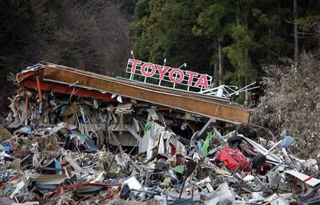 A Toyota dealership is seen at a devastated area after the earthquake and tsunami, in Minamisanriku town, Miyagi prefecture, March 22, 2011. Hundreds of parts suppliers in Toyota City have become victims of the earthquake and subsequent radiation leak at a power plant that have disrupted production and distribution in Japan's northeast. REUTERS/Carlos Barria