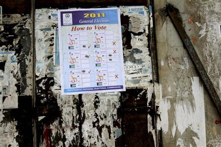 A poster showing how to vote is pasted on a wall at a polling centre before the postponement of the parliamentary election in Mushin neighbourhood in Nigeria's commercial Lagos April 2, 2011. REUTERS/Akintunde Akinleye