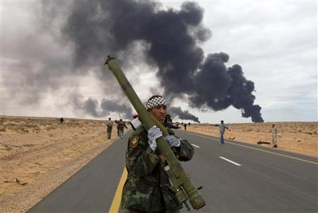 A rebel holds a man-portable air-defense system during clashes with pro-Gaddafi forces between Ras Lanuf and Bin Jawad in this March 9, 2011 file photo. REUTERS/Asmaa Waguih/Files